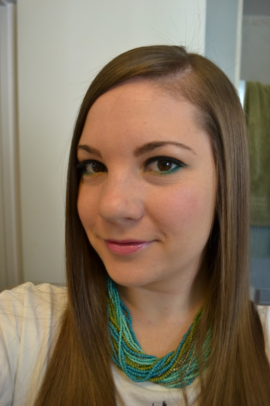 Cat Eye Surprise: Eye Makeup Look- Use a pop of turquoise under the eye for a fun springtime look. Clementinebean.wordpress.com